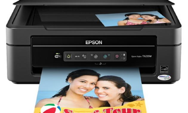 s USB cable is plugged into the reckoner or laptop EPSON STYLUS TX235W Driver Download